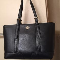 "Tory Burch ""Landon"" Black Leather Tote bag. NWT Very soft pebbled black leather with all gold hardware and is Brand New with attached tags. The leather shoulder straps can be adjusted to 5 different lengths.  Inside can hold a lot and has a zipper slip pocket and  3 vertical slip pockets for your phone. The top has a zip closure for added security and the bag is lightweight....perfect for every day use. Measurements: 16"" L X 9-1/2"" H X 5"" D with a 9"" handle drop on the second to loosest…"