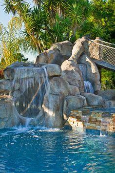 Pool with slide and bridge