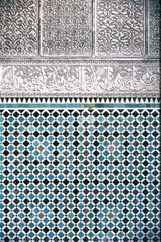 Image MOR 0305 featuring decorated area from the Attarine Medersa, in Fez, Morocco, showing Geometric Pattern and Calligraphy using ceramic tiles, mosaic or pottery and stucco or plasterwork.