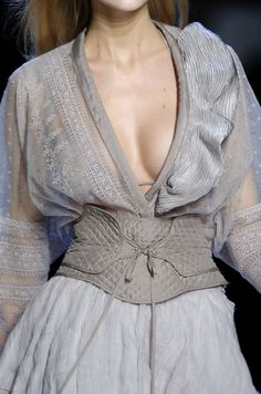 ZsaZsa Bellagio - women in the 15th century, along with the v cut, a wide stif belt was placed around the waist