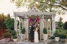 Love the flower wall for the ceremony
