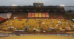 """Participants put together shelters using tents and cardboard boxes during the """"Reggie's Sleepout"""" event at Jack Trice Stadium on Saturday. Photo by Nirmalendu Majumdar/Ames Tribune http://www.amestrib.com/news/20170325/community-braves-cold-rain-for-youth-homelessness-at-reggie8217s-sleepout"""