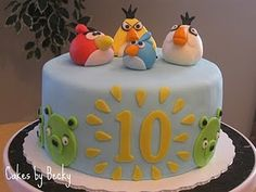 Angry Birds cake for my Son's 10th Birthday :) Vanilla cake with vanilla swiss meringue buttercream filling covered in fondant. All the birds were hand formed using a fondant/gum paste mixture!