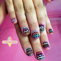 Bright colored tribal nail art!