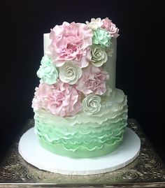 - Mint and blush bridal shower cake.