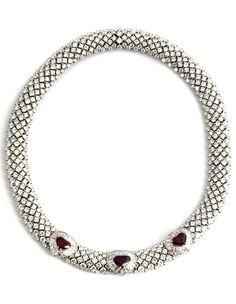 Halsweite: ca. 39,5 cm. Gewicht: ca. 123,2 g. WG 750. Prächtiges, schlangenartiges Collier mit hochfeinen Brillanten und Diamanten im Baguette- und...