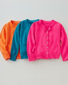 Buttoned up, but far from boring, this cardigan is beautifully bold in a trio of bright, saturated colors.
