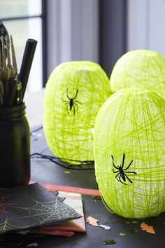 Halloween Spider Nest Lanterns YOU'LL NEED: Two 1-liter soda bottles Craft knife Clear packing tape Cheesecloth Cotton string Plastic spiders Battery-operated tea lights