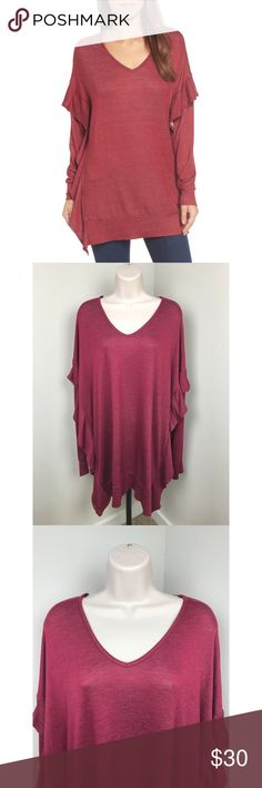 NWT Pleione $52 Ruffle Tunic Blouse L NWT Pleione tunic Size large Ruffle detailing down the sides Rayon/Poly blend - super soft and stretchy Brand new, PERFECT condition! Retail price - $52    length - approx 32 inches armpit to armpit - approx 24 inches Pleione Tops Tunics