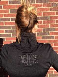 I embroidered a monogram on the back of my running athletic shirt:) I used Jolson's interlocking font! My friend showed me how to do the monogram in the hoop with pins and how to use my Sew What Pro software:)
