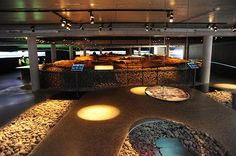 """The Settlement exhibition displays a Viking-Age longhouse dated to around 930 AD.  It was found in archaeological excavations in the centre of Reykjavík in 2001. The ruins of the longhouse and a part of a man made structure – a turf wall, have been preserved and are now on display """"on site""""."""