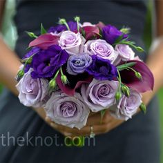 Pretty purple bouquet of Ocean Song roses, Mokara orchids and calla lilies