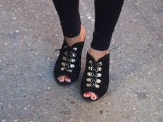Laced up mules adding a touch of boudoir to black jeans