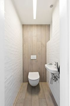 The Sounding Space: A Combination of Minimalist, Modern, and Industrial Interior with Oriental Elements Toilet Room Decor, Small Toilet Room, Guest Toilet, Bathroom Design Small, Bathroom Interior Design, Bathroom Styling, Industrial Interior Design, Industrial Interiors, Minimalist Toilets