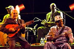 """Buena Vista Social Club at the o2 - April 2016 - There they were on a giant screen, in death larger than life: impish crooner Ibrahim Ferrer, double-bassist Cachaito López, pianist Rubén González, whose playing style Ry Cooder likened to """"a cross between Thelonius Monk and Felix the Cat"""". The show included original band members: Omara Portuondo, Papi Oviedo, Barbarito Torres, Eliades Ochoa and Manuel """"Guajiro"""" Mirabal"""