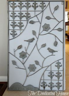 Lovely ironwork wall decor.  http://thededicatedhouse.blogspot.com/2013/05/my-little-shopping-spree.html