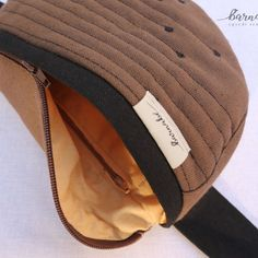 Brown Fanny Pack for women and girls  It is a cool and youthful looking fanny pack, made from strong canvas material. It is very practical for occasions where you need both of your hands such as festivals, running, biking or hiking. Also ideal for babywearing.  It has a main zip pocket and a smaller inner zip pocket. The size of the pack is approximately 30x20cm. It doesn't have a buckle so it is comfortable and highly adjustable. You can self-tie it with the canvas belt (140cm).  Bum Bag, Babywearing, Canvas Material, Biking, Sling Backpack, Fanny Pack, Festivals, Strong, Hands