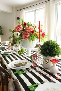 Staying Home on Valentines Day? Learn how to set a beautiful black white pink and red table and create a bright whimsical tablescape. Layer on the Love with a gorgeous floral arrangement