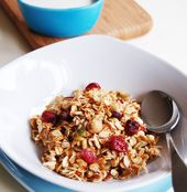 3 cups of rolled oats  ¼ cup of sunflower seeds  ½ cup of slivered almonds  ¼ cup of hazelnuts  ½ cup of desiccated coconut  ¼ cup of pumpkin seeds  ½ cup of honey  1 ½ tbs of canola oil  ½ cup of dried cranberries or apricots, roughly chopped  Milk and or yogurt to serve