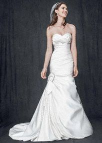 Breathtakingly beautiful, this satin mermaid gown is stylish and sophisticated. Sweetheart satin bodice is feminine and flattering. Empire waist features delicate beaded detail. Bow detail and bubble hem add a modern touch. Chapel train. Fully lined. Back zip. Imported polyester. Dry clean only. Available in stores and online in Ivory. White available by special order in stores. Also available for special order only in Petite sizes 0P-16P, Style 7V3204, and Plus sizes ...