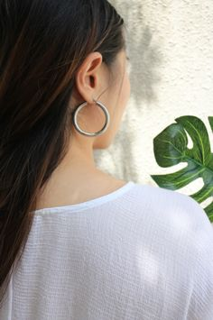 Have a poolside look with a statement with these silver hoops from @thehexad. Shop online at www.thehexad.com