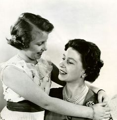 A tender image of Princess royal Anne with her mother, Queen Elizabeth II. Early 60s.