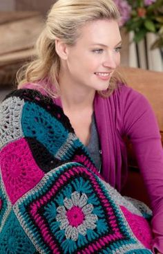 Time to Relax Granny Throw Crochet Pattern - Small solid color squares and large squares are combined for an interesting granny throw— definitely not like grandma's. Shown in a contemporary color combination that is great to relax with after a demanding day.