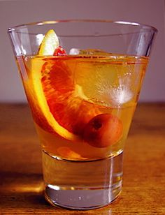 """12 Thanksgiving Cocktail Ideas - Including """"The Jack O'Lantern""""(whiskey, apple cider, pumpkin puree, maple syrup, spices) or """"Thieves' Punch"""" (rum, port, lime juice, sugar, bitters)"""