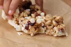 No-Bake Cereal Bars ½ cup honey ¼ cup peanut butter 3 cups toasted oat cereal 1 cup yogurt chips (save ½ cup for melting) ½ cup unsalted toasted almonds, chopped ½ cup dried cranberries  Microwave pb and honey 45 seconds. Mix all. Spread I'm pan on wax paper. Freeze 45 minutes. Dip in yogurt chips. Cut and wrap.