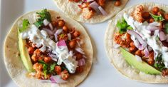 Roasted Cauliflower Chickpea Tacos With Cilantro Lime Crema #healthy #tacos #veggie