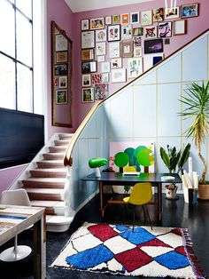 love this dramatic colorful eclectic staircase | colorful house tour on coco kelley