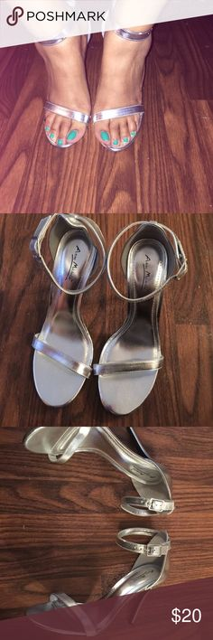 New silver ankle strap heels New never worn. silver ankle strap heels. No original box. Anne Michelle Shoes Heels