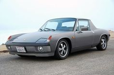 This 1974 Porsche 914 has been transformed into a very clean 914/6 reproduction, with a rebuilt 2.4L 6-cylinder from a 911 fitted with dual 40mm Weber carbs, and a host of other nice upgrades. The grey metallic paint looks very well done, with a matching smoothed targa roof and proper 5-lug upgrade.