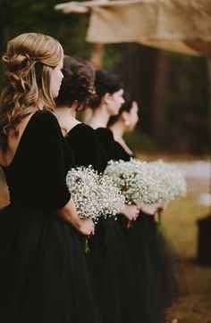 Black bridesmaids' dresses and baby's breathe bouquet