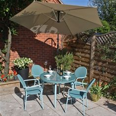 Retro Styling with a twist. Hampton 4 Seat Pastel Rattan Garden Furniture in  Sage Green with stacking chairs. Powder coated aluminium with PE rattan for low maintenance.........and eventually fully recyclable