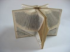4 used books with geometric folds into art 'Whirled Books' by Anita Francis at booksandjackets.blogspot