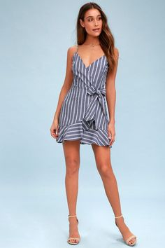 VOYAGE BLUE AND WHITE STRIPED WRAP DRESS-Hi Ladies, This dress is so sweet and feminine! Perfect for warm Spring nights!! The Fifth Label Voyage Blue And White Striped Wrap Dress is so adorable! This piece has a v- neckline with surpliced wrap, it has a cute little side tie...adorable! The waist of this dress is more fitted while the s