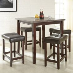 The Steve Silver Co. Aberdeen Counter Height Dining Set exudes simple elegance and purpose. Featuring a counter height table and four coordinating stools, this set adds a sophisticated touch of high-quality attraction to your dining area. Dining Room Sets, Kitchen Dining Sets, Counter Height Dining Sets, Pub Table Sets, Counter Height Stools, Small Dining, A Table, Dining Area, Dining Table