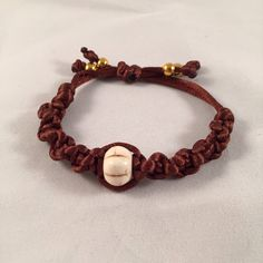 Brown braided bracelet, polyester, charm bracelet by HaydeeDesigns on Etsy https://www.etsy.com/listing/227089984/brown-braided-bracelet-polyester-charm #handmade #jewelry #mothersday #etsyshop #jewelrydesign #jewelryonetsy #mom #love