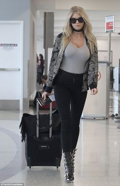 Busting out:  Charlotte McKinney proved she could turn heads fully dressed as she arrived ...