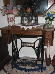 I showed the little cabinet my husband made with the Singer drawers I bought, Here is my grandmother's 1926 treadle Singer I wanted the purchased drawers to match.  BTW, the treadle Singer works perfectly!