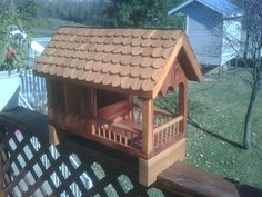 Feeder is made from red cedar. The top is hinged to allow access to the feed bin. I covered the roof with roofing metal before making individual cedar shingles. Outdoor Crafts, Outdoor Projects, Wood Projects, Squirrel Home, Squirrel Feeder, Bird House Feeder, Bird Feeders, Pallet Crafts, Nesting Boxes
