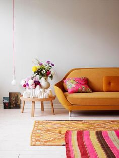 Add a splash of colour to your home, ever considered an orange sofa? #interiordesign