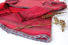 Coral and red wine. Woolen knitted jumper. Pullover coral red