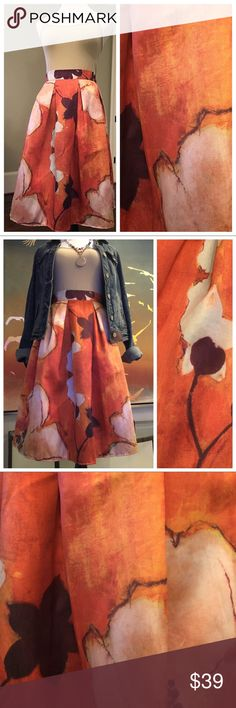 "Burnt Orange Floral Midi Skirt - Reposh  Reposhing this beauty. Never had a chance to wear it - waist too snug for my liking. So perfect for Fall with a denim jacket! I recently received this skirt with no tag. Fits like an XS: waist 13"" across; length 24"". Waist has some stretch as well. Lovely midi skirt has a short (mini length) liner inside as well. Believe the fabric is polyester. No damage. Like new, but without tag. Just gorgeous floral fabric! Guess I needed one size larger... Skirts…"