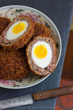 Scotch Eggs - hard boiled eggs wrapped in ground sausage, then breaded (twice), then fried until crispy and golden brown on the outside