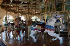 Pictures of the wooden horses carved in 1895 in the Historic Carousel at Seaport Village, San Diego,CA