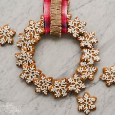 Here's how to make an edible gingerbread cookie wreath:  This would make a fun gift!