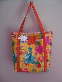Cool beach bag made from a plastic picnic tablecloth!  Love outside the box materials!