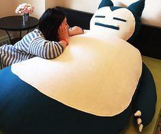 Take relaxation to the max by plopping down on the bountiful stomach of your very own Snorlax bean bag. This giant Snorlax requires about 10 cubic feet of stuffing to be filled up and comes with a sturdy double zipper to prevent accidental spill.